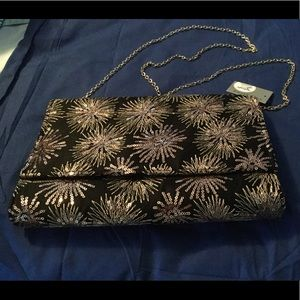Rose gold starburst clutch with chain